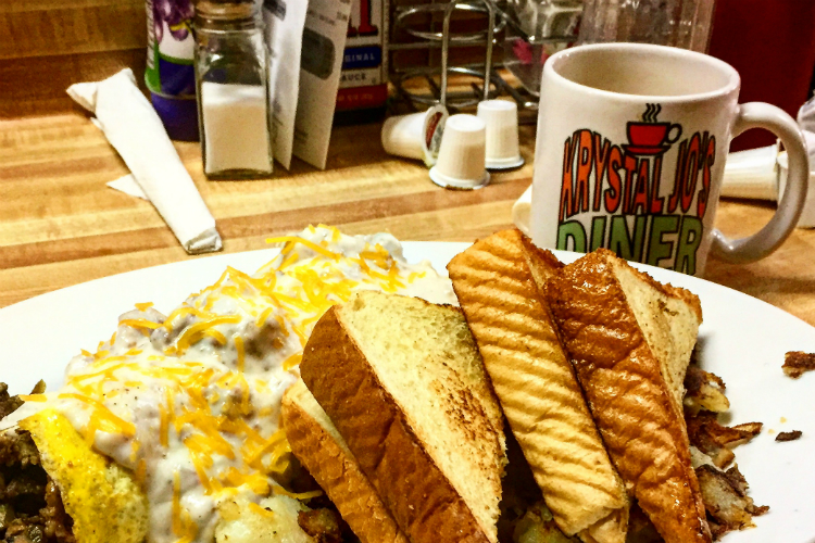 The Classic Country Omelette at Krystal Jo's features sausage gravy, bacon, beff, jalapeno, cheese, onions and green peppers all wrapped up with fresh eggs.