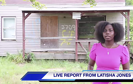Flint native Latisha Jones standing in front of her childhood home.