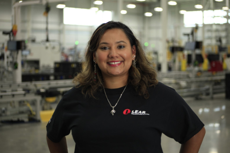 Ismeralda Moyet lives in Pontiac, but says she's fallen in love with working in Flint since hiring into the Lear factory at Buick City.