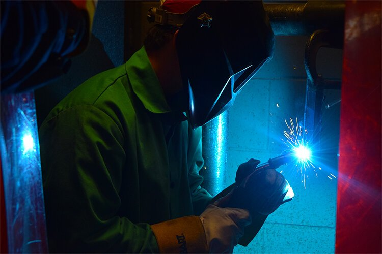 GCI welding student and Flushing High School senior, Luke Kenrick, practices his welding technique.