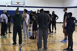 Kevin Mays (left, grey hat) talks with players trying out for Flint United during a training camp in January 2021.