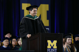 Dr. Bobby Mukkamala delivers the keynote address during UM-Flint's December 2018 commencement ceremony.