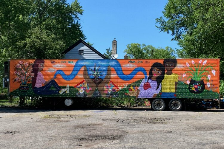 A look at the completed mural on the Joy Tabernacle water distribution trailer.