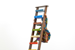 "Yinka Shonibare CBE, ""Magic Ladder Kid VI,"" detail, 2018, Fiberglass mannequin, Dutch wax printed cotton textile, wooden ladder, hardback books, globe, buckram cloth and steel baseplate, 113.18"" x 58.26"" x 31.49"".  © Copyright Yinka Shonibare CBE, 20"