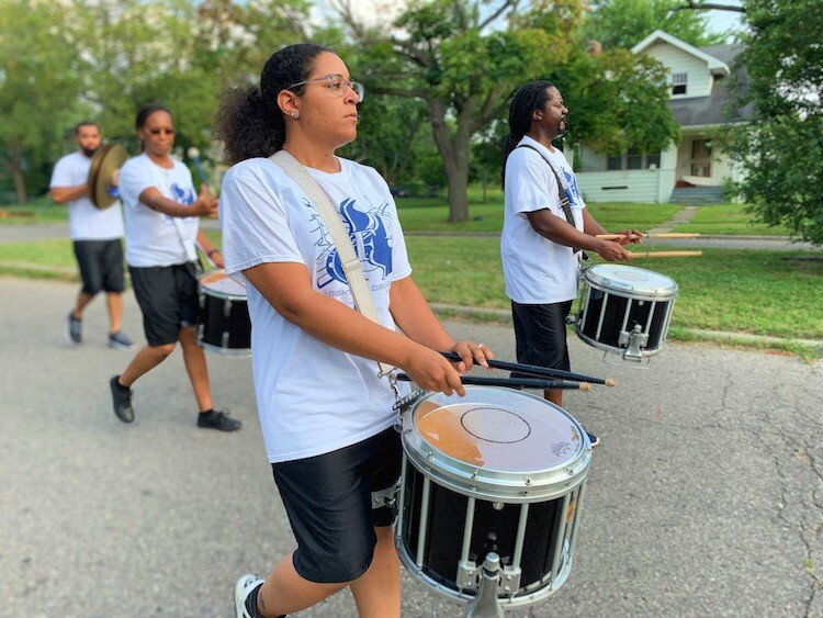Kayla Wilson, 28, marches in the Civic Park Art Parade with her snare in in the Nightfire Drumline team. This is their sixth year providing percussion for the Flint Public Art Project Neighborhood Art Parades.