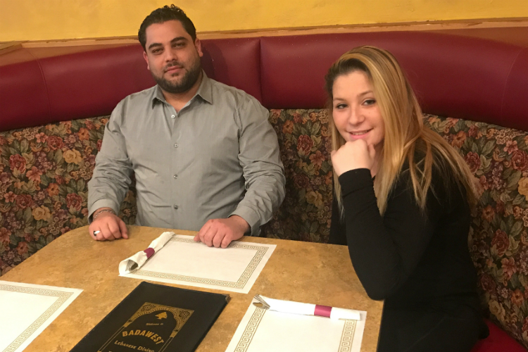 New co-owner Ali Shamass of Badawest on Corunna Road sits with veteran waitress Katelin Miller.