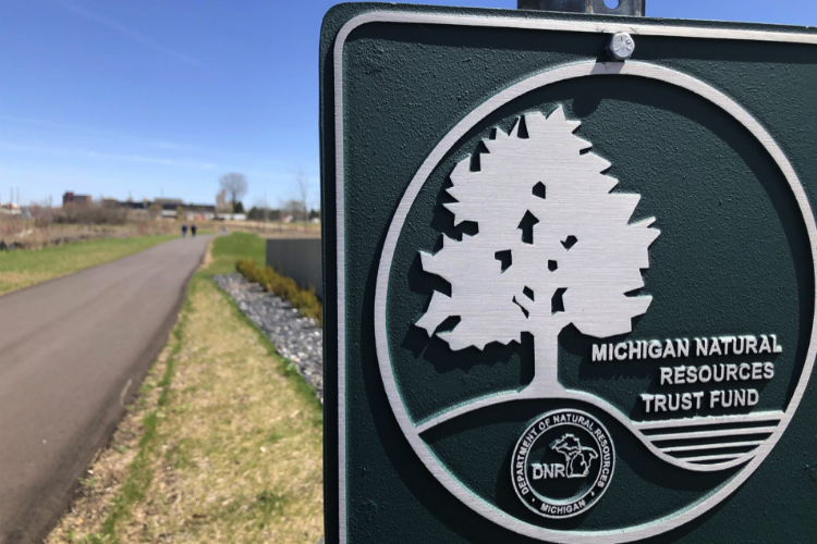 A new 1-mile section of trail stretches from Chevrolet Avenue to Factory One, offering additional access to the Flint River and views of downtown Flint.