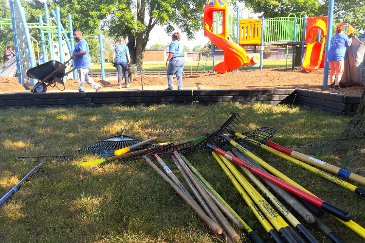 More than 100 volunteers helped to ready the new playground at Hasselbring Senior Center before it opened on Tuesday.