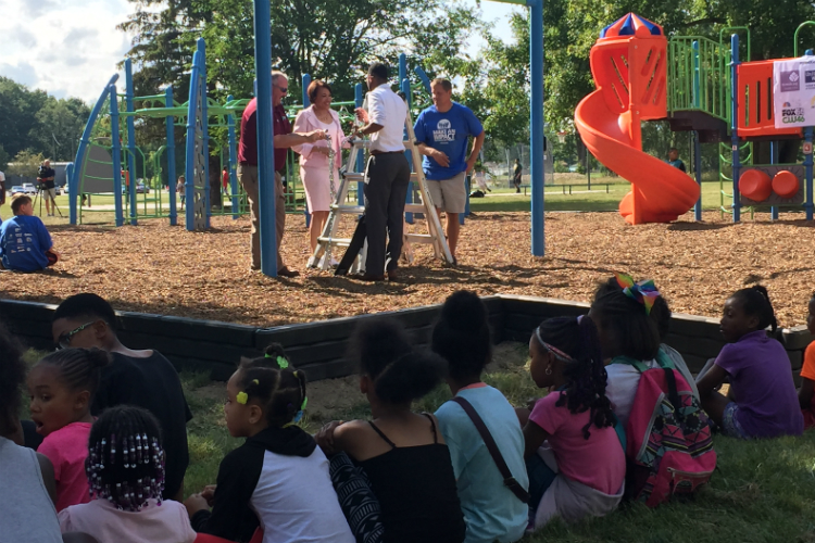 Key organizers talk just prior to the official opening of the new playground at Hasselbring Senior Center in Flint.
