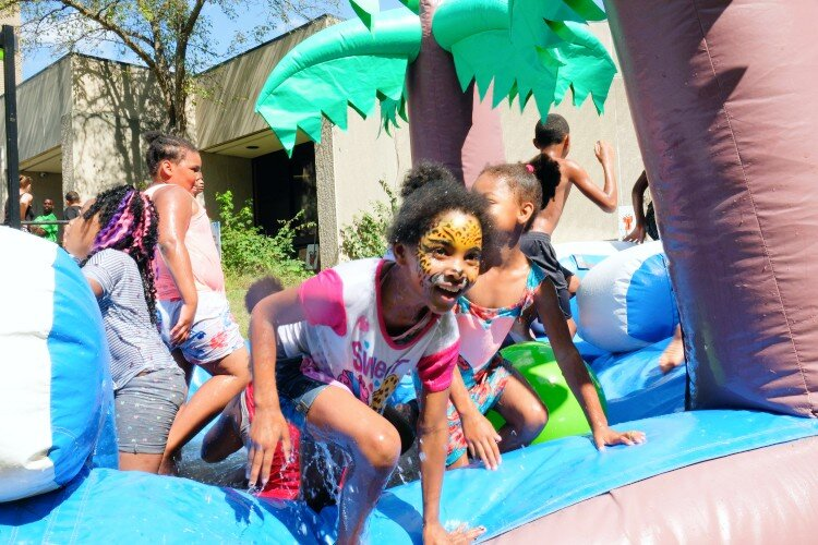 "Kids play in front of Haskell Community Center at the 2nd Flint Town ""Back to School"" Carnival Splash, Saturday August 17."