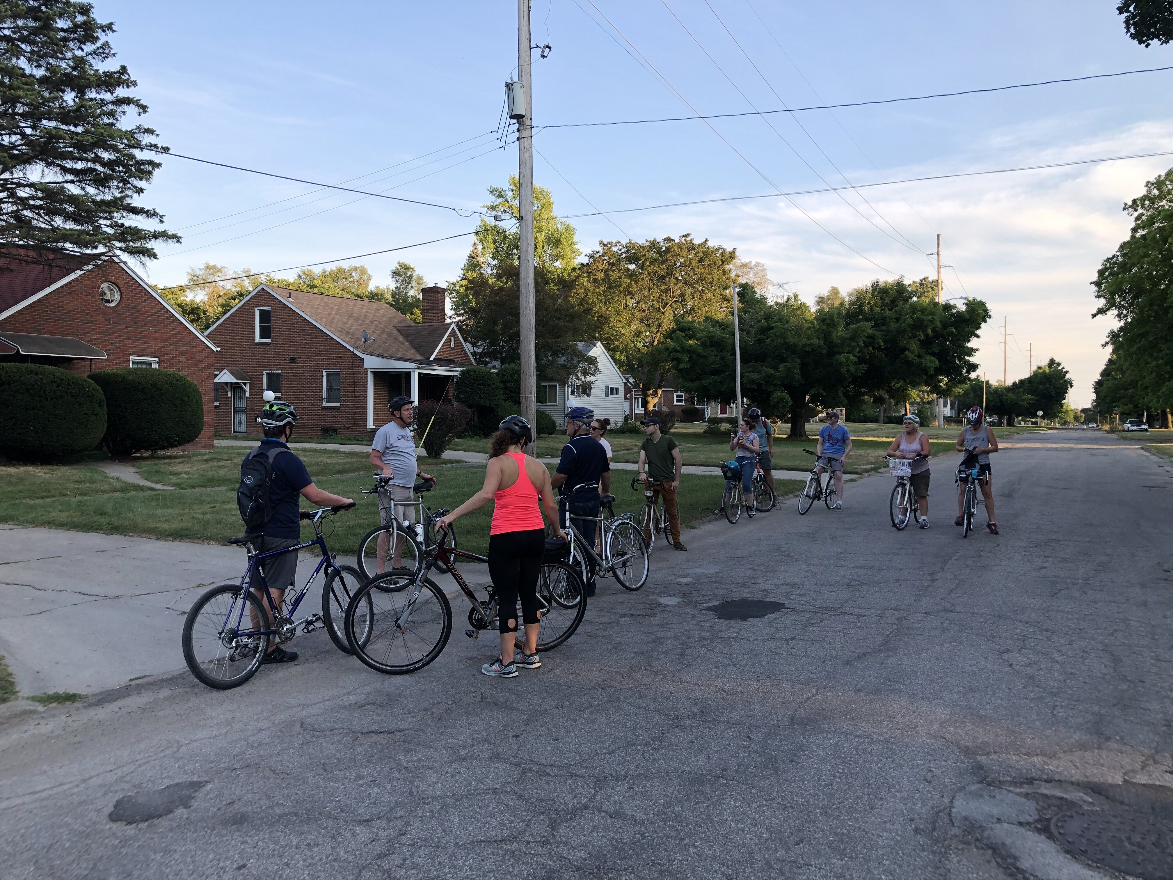 Thomas Henthorn discusses housing discrimination in Flint with participants on a Flint City Bike Tours tour in August.