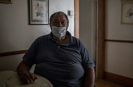 James Riley sits at his dining room table inside his home in Flint, Michigan.