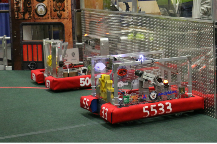 Robots line up at the start of competition at the FIRST Robotics district games at Kettering University in March.