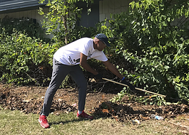 Resident Antoine Little working during a cleanup in the Sarvis Park area in Flint.