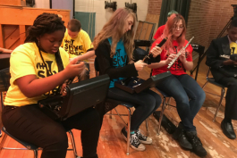 Students at Scott Middle School check out the new instruments provided through VH1 Save the Music Foundation.