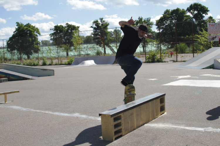 "A skater that goes just by Carlos, from Traverse City slides along a rail. ""I always come back to skate Flint because of the people,"" he said."