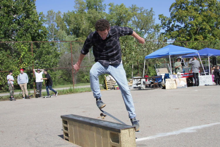 Jon May hits the rail during the benefit for the Flint Skate Park.