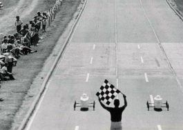 This image shows the finish line of a Soap Box Derby Race at Donald R. Cronin Soap Box Derby Downs behind Southwestern Academy.