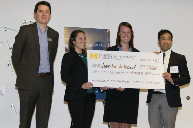 The winning team, Innovation to Impact, took home a won a $2,500 prize. Martha Fedorowicz partnered with students Emily Futcher and Dean-Mark Clemente to develop their plan focusing on downtown training and neighborhood outreach.