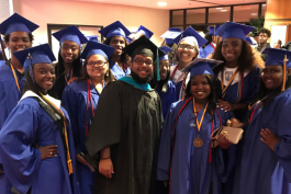 2018 graduates of Flint Southwestern Academy pose for a photo with Community School Director Mohammed Aboutawila after graduation in June.