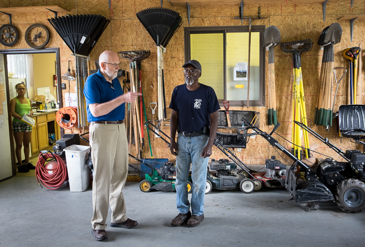 Hurb Pitts (right) talks about the condition of equipment with NEH board member Jim Richardson.