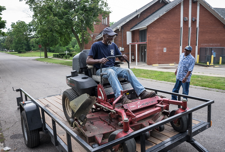 Hurb Pitts delivers a mower to Deacon Darris Berry at Shiloh Missionary Baptist Church.