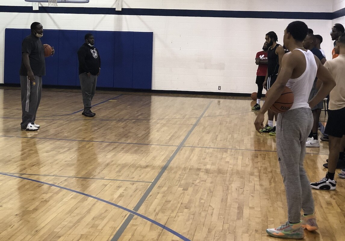 Former Flint Northwestern and Michigan State star Kelvin Torbert talks with athletes during a Flint United tryout on January 17.