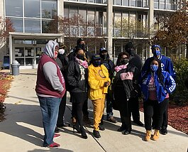 Organizers of a #walkthevote parade in Flint in front of City Hall on November 1.