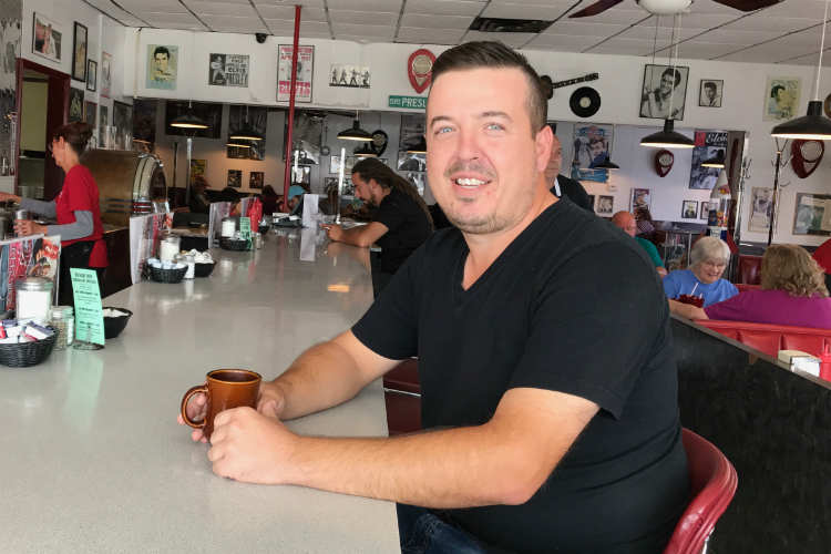 Frank Dinaj, co-owner of Westside Diner since 2002, can be found behind the grill daily.