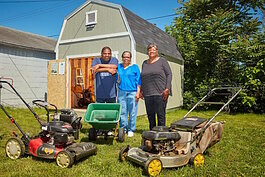 Willie Smith and fellow members of the West Pulaski Street Block Club stand in front of their community tool shed built with a $5000 grant awarded by Community Foundation of Greater Flint Neighborhoods Small Grants Program.